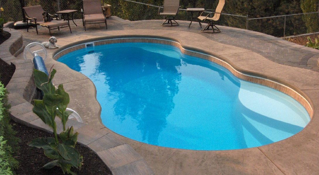 """The Lelani is a medium sized free form fiberglass pool with a shallow end tanning ledge. It fits conveniently in small to medium sized backyards, due to its overall length of only 23' 9"""". This swimming pool is perfect for a small to medium sized family that wants a great place to respire from life's hustle and bustle."""