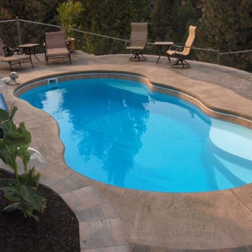 "The Lelani is a medium sized free form fiberglass pool with a shallow end tanning ledge. It fits conveniently in small to medium sized backyards, due to its overall length of only 23' 9"". This swimming pool is perfect for a small to medium sized family that wants a great place to respire from life's hustle and bustle."