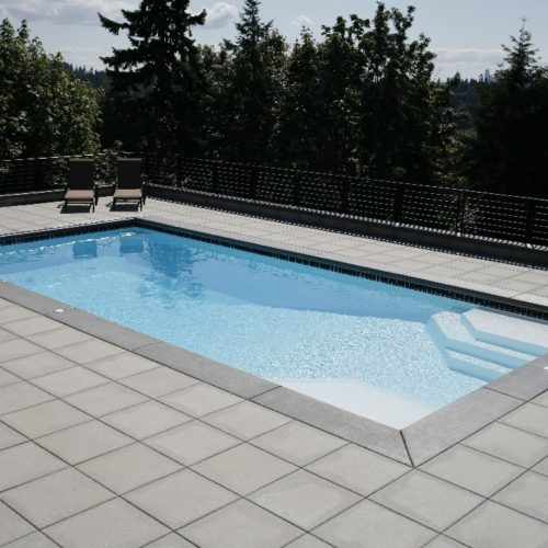"The Niagara is a rectangular fiberglass swimming pool, very similar to the Luxor Deep End pool. We've slightly altered this shape so that it provides a modest 33' length paired with a 7' 9"" deep end. It's perfect for medium to large sized backyards and works excellent for regular aerobic activity."