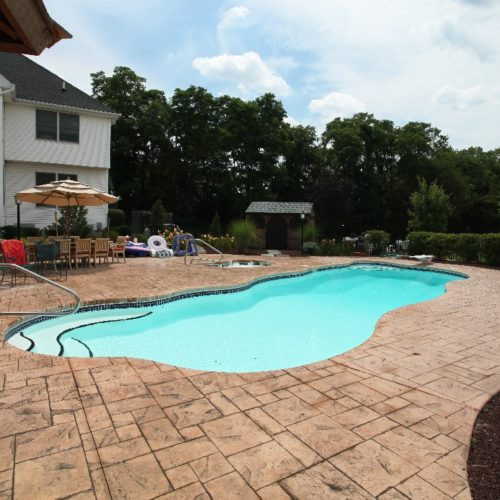 "The Stardust is a beautiful free form fiberglass swimming pool. It is classified as a medium sized pool with a modest deep end of 6' 4"". It provides your swimmers lots of space to stretch out while enjoying its multiple design features."