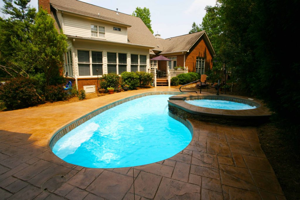 The Seaside is a beautiful fiberglass pool designed for small to medium sized backyards.