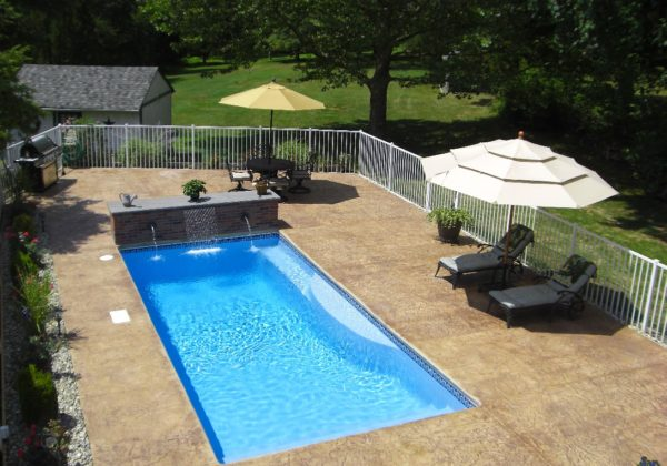 The Wylela is a classical rectangle fiberglass pool with a fun personality! This gorgeous pool layout consist of a full width shallow end entry steps, deep end and set of deep end benches!