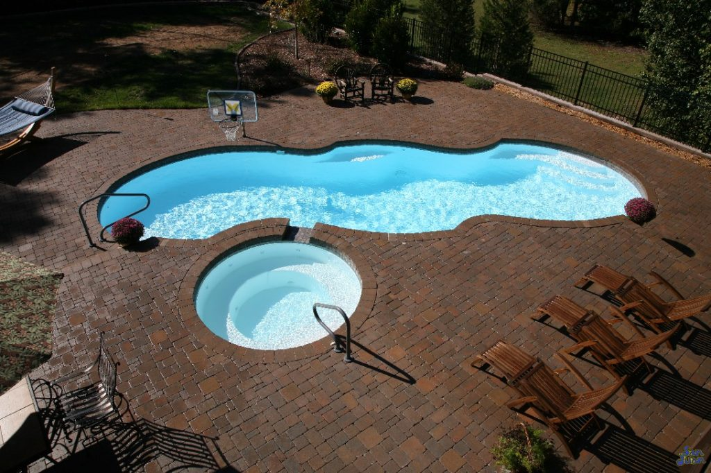 """The Mirage is a Sport Bottom Hopper (Deep End) design with a mirror layout. This pool is extra large with an overall length of 39' 8"""" & a modest width of 15' 8"""". It provides a large footprint for maximum swim space and outdoor fun!"""