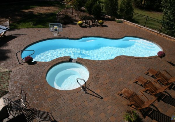 "The Mirage is a Sport Bottom Hopper (Deep End) design with a mirror layout. This pool is extra large with an overall length of 39' 8"" & a modest width of 15' 8"". It provides a large footprint for maximum swim space and outdoor fun!"