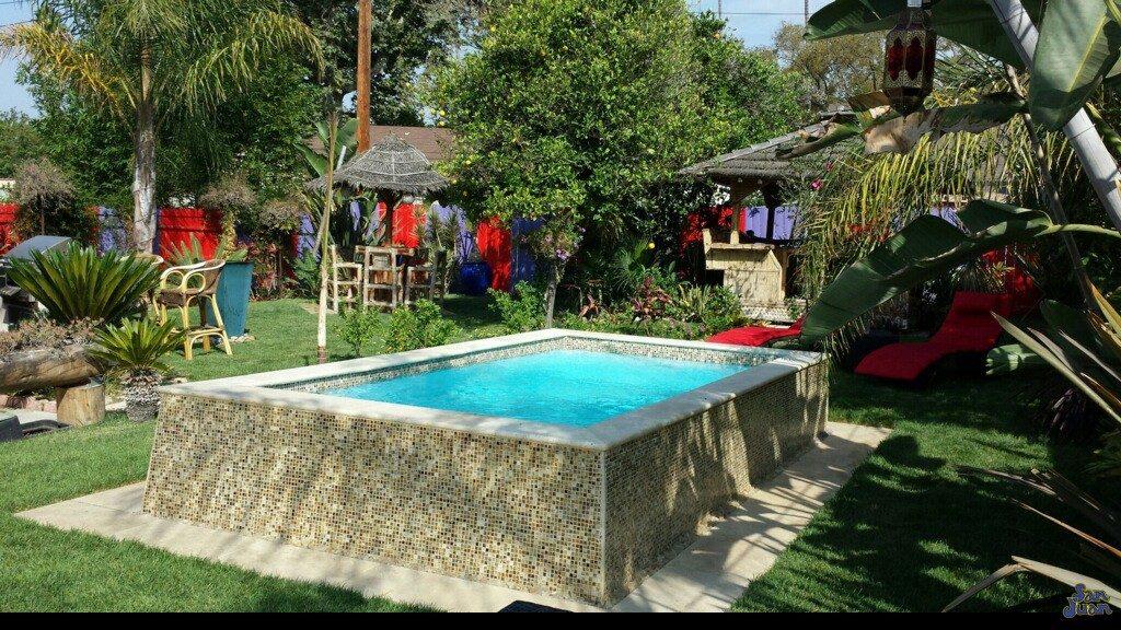 The Sedona built above ground in a serene backyard
