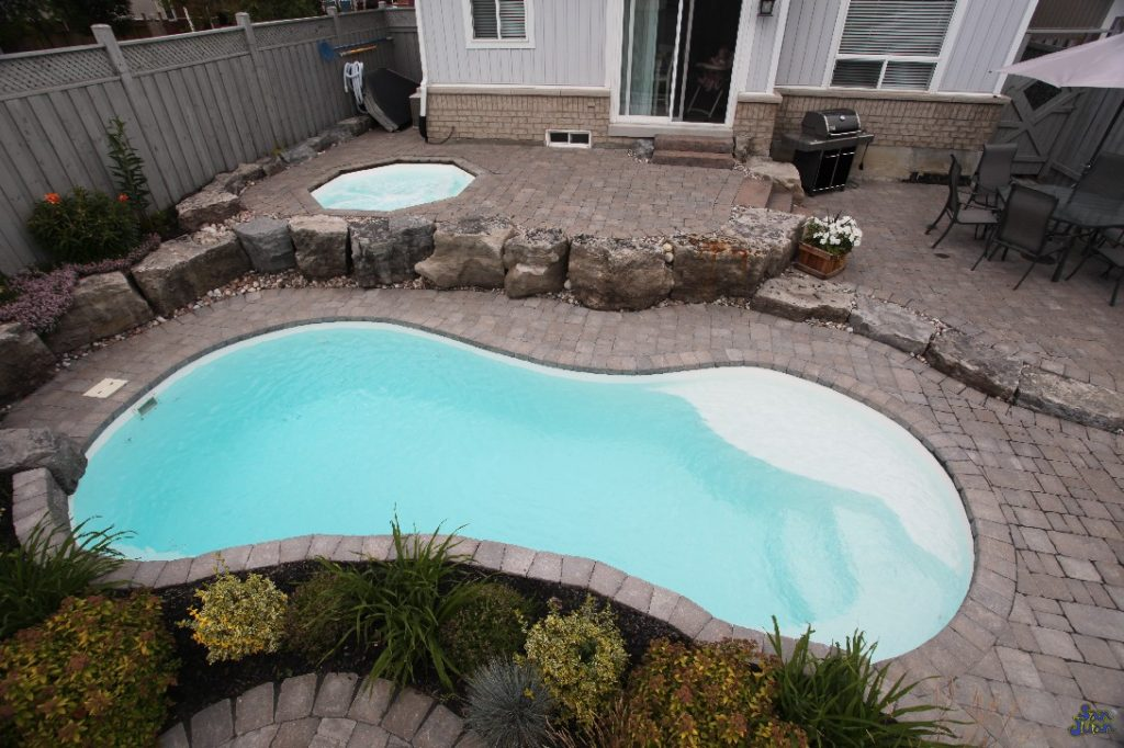 The Sundial is a classic figure-8 style swimming pool. Although it provides plenty of swim space, it's compacted into a small body of water. Holding only 6,400 gallons, the Sundial is a petite fiberglass pool shape perfect for small backyards!
