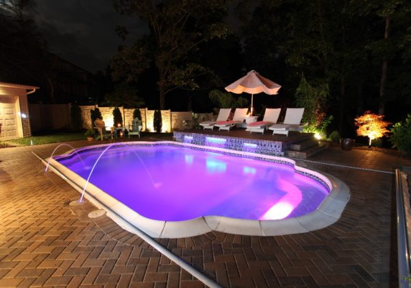 The Vegas is a stunning display of how beautiful a fiberglass pool from San Juan Pools can be! As the sun goes down, the night life is just beginning! Bring a little bit of Vegas back home with this elegant and beautiful Grecian pool shape!