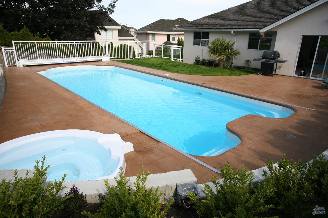 "The Dallas is joining our classification of ""Big Boy"" fiberglass swimming pools. This huge fiberglass pool includes a 7' 11"" deep end and overall length of 42' 4"". As big as the state of Texas, this pool provides a huge amount of space for creating fun backyard memories!"