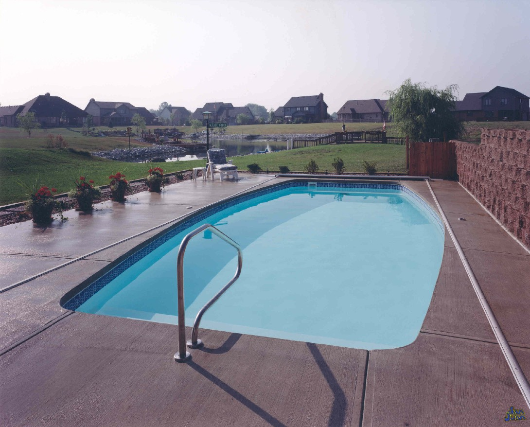 "The Majestic is a serene body of water with a conservative pool shape. Representative of a blend between an oval and a rectangle, the Majestic is a modern design with a modest deep end. It's overall depth of 5' 5"" makes this swimming pool very safe and friendly to entry level swimmers."
