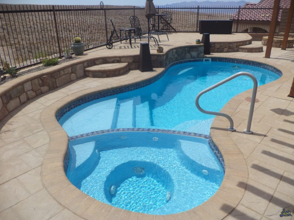 The Mandalay Bay is considered one of our all-in-one fiberglass swimming pools. It includes a free form shape, attached spa, dual entry steps, bench seating and modest deep end. If you're looking for a fiberglass pool that does it all, chances are the Mandalay Bay is the perfect selection for you!