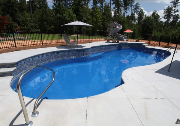 "The Oasis is ready to become your own personal oasis! This creative swimming pool provides ample space to maximize the summer fun! From a 7' 11"" deep end, to free form layout, bench seating & curved bench seating; it does it all. Find out more about this amazing fiberglass pool below."