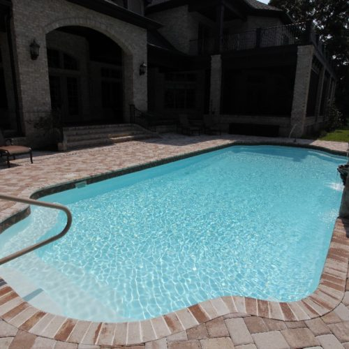 The Phoenix is a fiberglass swimming pool with a modern touch. Designed as a Grecian layout, the Phoenix resembles a rectangular shape with bell-end curves on each end. In addition, we've utilized a Sport Bottom Hopper which means the deep end is right in the middle of its body.