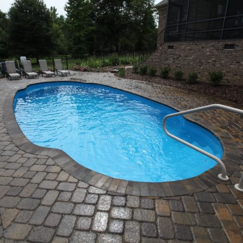 The Pompano Beach is an elegant redesign of a classic Roman Pool Shape. This beautifully designed fiberglass pool includes a wide deep end bench & curved entry steps. It's standard hopper layout is a classic presentation of shallow end to deep end layout. Perfect for your home!
