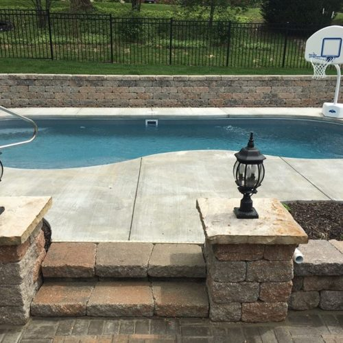 "The Sandcastle is a serene free form swimming pool with a 5' 5"" deep end. It provides ample bench seating for your swimmers and guest as well as a nice tanning ledge. This is a great swimming pool for those who want to casually swim and relax with friends and family."