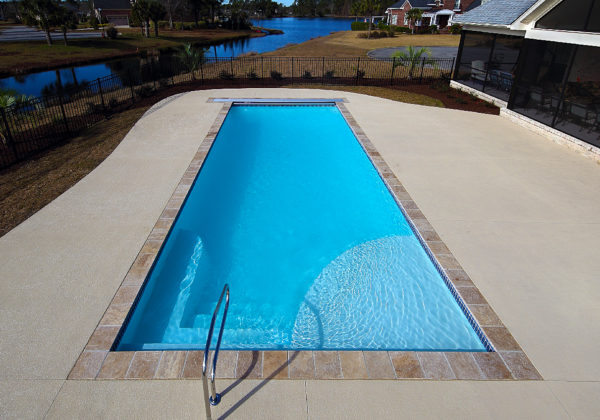 "The Great Lakes is an elegant, rectangle fiberglass swimming pool. It includes a wide tanning edge, corner entry steps and a 6' 4"" deep end. You can enjoy some sun bathing and lap swimming in this elegant pool shape!"