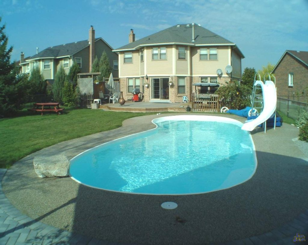 """The Manatee Deep is a stunning kidney-shaped fiberglass swimming pool. This beautiful pool includes an 8' deep end and is based on it's little sister: The Manatee Shallow. You'll love the compact 32' 10"""" length which fits perfectly into medium / large sized backyards."""