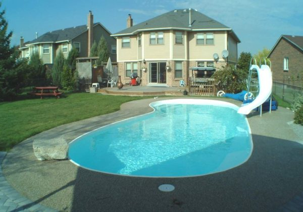 "The Manatee Deep is a stunning kidney-shaped fiberglass swimming pool. This beautiful pool includes an 8' deep end and is based on it's little sister: The Manatee Shallow. You'll love the compact 32' 10"" length which fits perfectly into medium / large sized backyards."