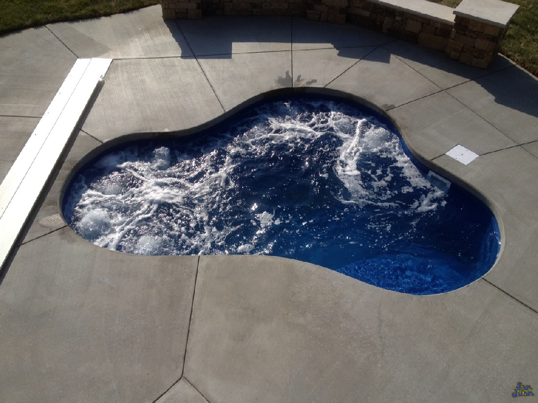 The Montreal Spa is a medium sized fiberglass spa that holds a maximum of 1,925 Gallons. This free form design has less bench seating than the Sydney or Vancouver - comfortably holding 2-4 bathers in its serene waters. This unique spa shape is perfect for a petite backyard or as an addition to any of our fiberglass pool shapes.