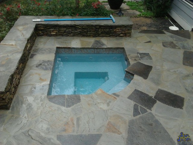 The Cove Spa is a modern fiberglass spa shape that can comfortably hold up to 3 bathers. This modern design is actually our smallest fiberglass spa model - which makes it perfect for small backyards!