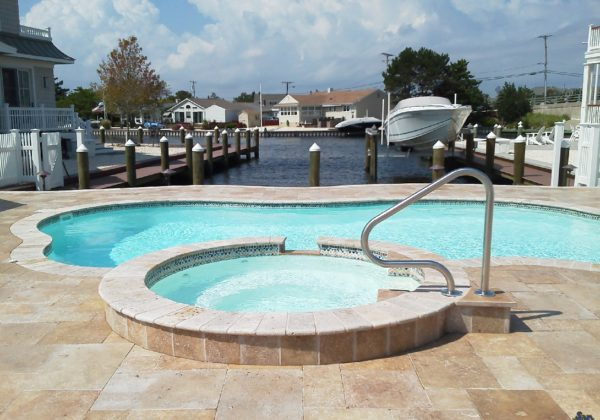 The Isle Spa is a beautiful fiberglass spa that pairs exceptionally well with nearly all of our fiberglass pool designs! It blends perfectly with nearly every swimming pool and you can even create unique spillover effects by elevating it above the swimming pool!