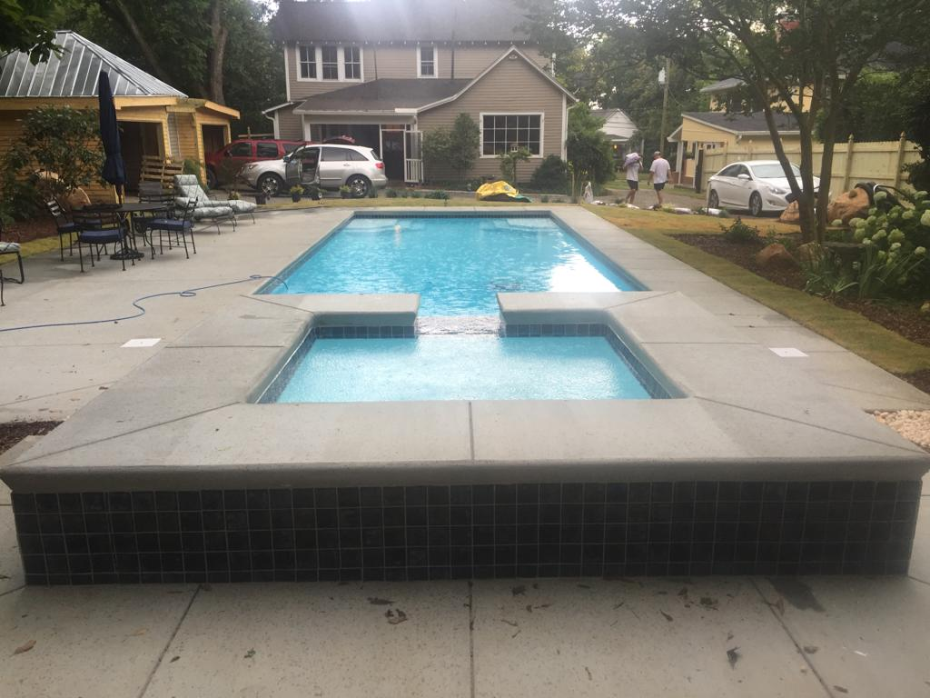 Here is another image of a Lido Spa installed with a spillover effect into the fiberglass below.