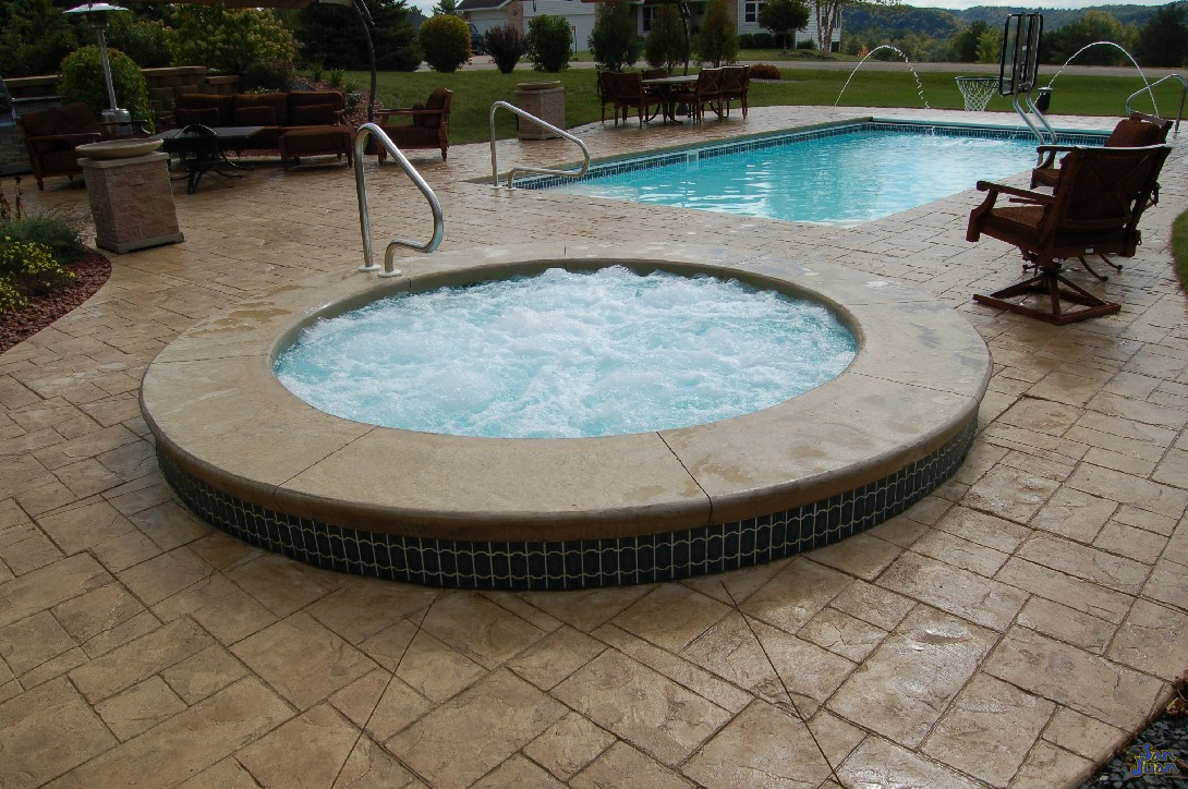 The Sarasota Spa is a quaint & round fiberglass swimming pool that adds on perfectly to any fiberglass swimming pool. This petite shape is large enough to hold four bathers and includes a spillover effect.