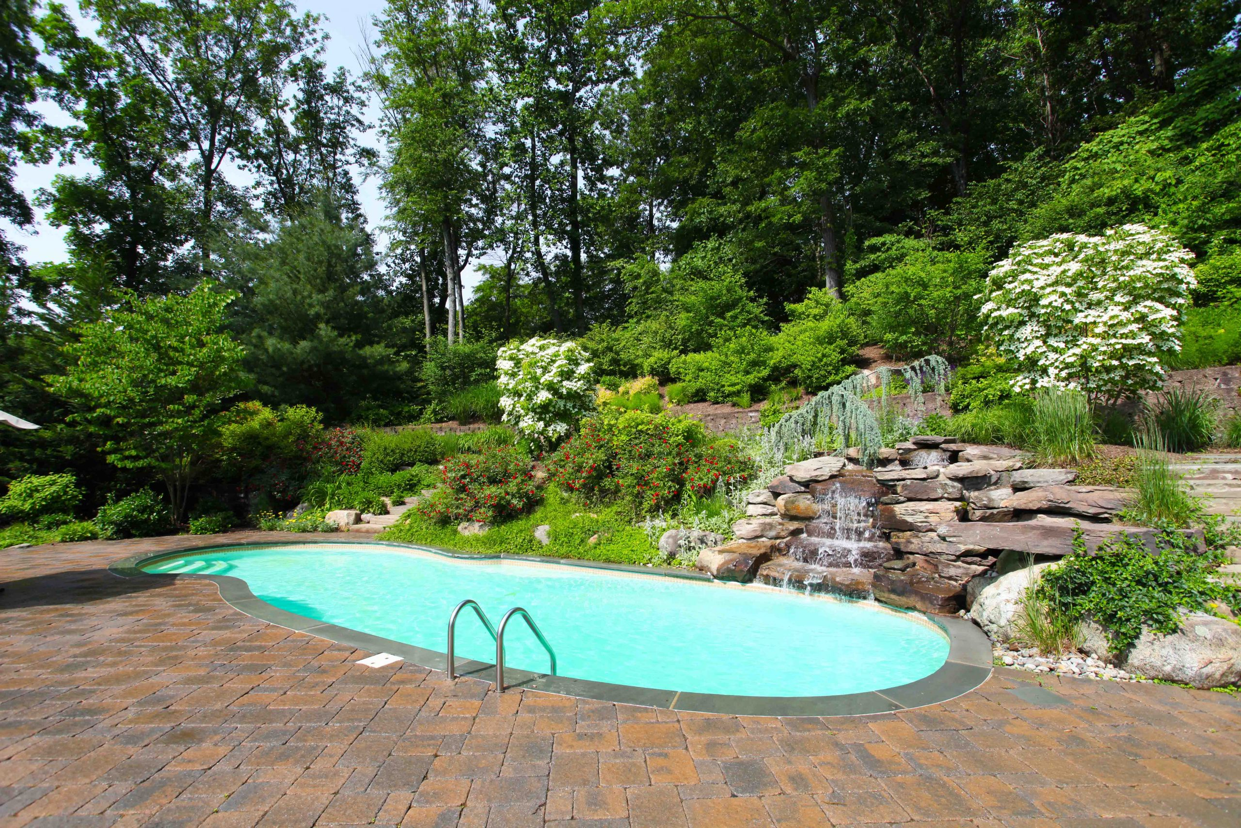 The Oasis is a free form fiberglass swimming pool designed to provide room for loads of summer fun.
